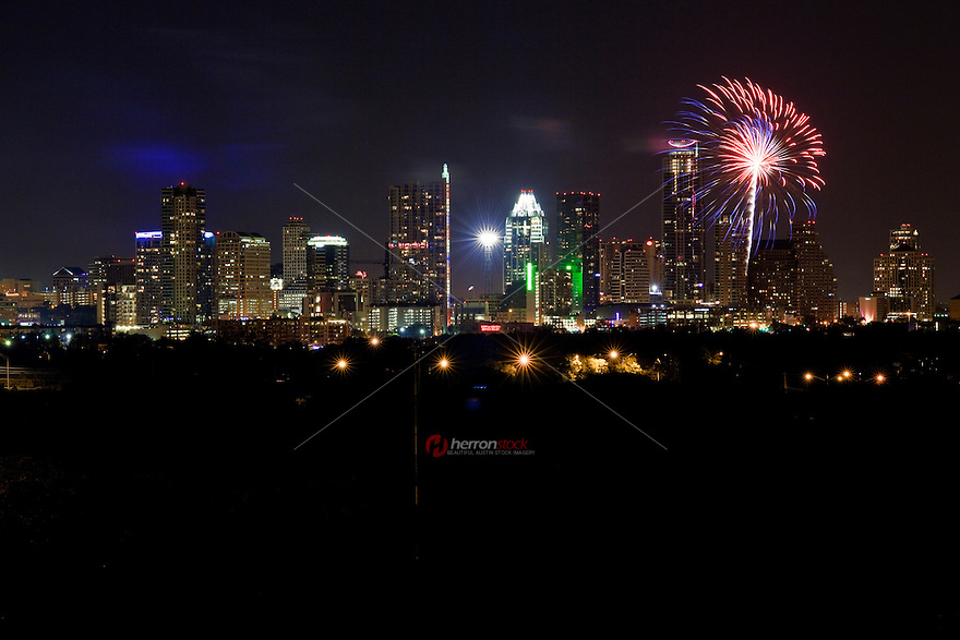Colorful fireworks shoot over the downtown skyline in Austin, Texas
