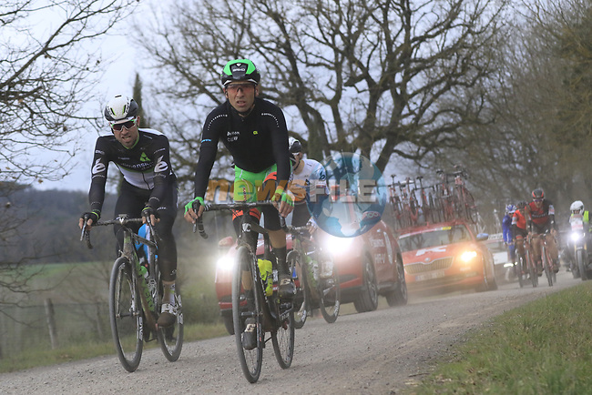 The peloton including Bernhard Eisel (AUT) and team mate Edvald Boasson Hagen (NOR) Dimension Data on gravel sector 4 Commune di Murlo during the 2017 Strade Bianche running 175km from Siena to Siena, Tuscany, Italy 4th March 2017.<br /> Picture: Eoin Clarke | Newsfile<br /> <br /> <br /> All photos usage must carry mandatory copyright credit (&copy; Newsfile | Eoin Clarke)
