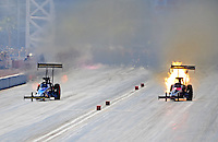 Oct. 29, 2011; Las Vegas, NV, USA: NHRA top fuel dragster driver Ike Maier (right) has a fire alongside Cory McClenathan during qualifying for the Big O Tires Nationals at The Strip at Las Vegas Motor Speedway. Mandatory Credit: Mark J. Rebilas-