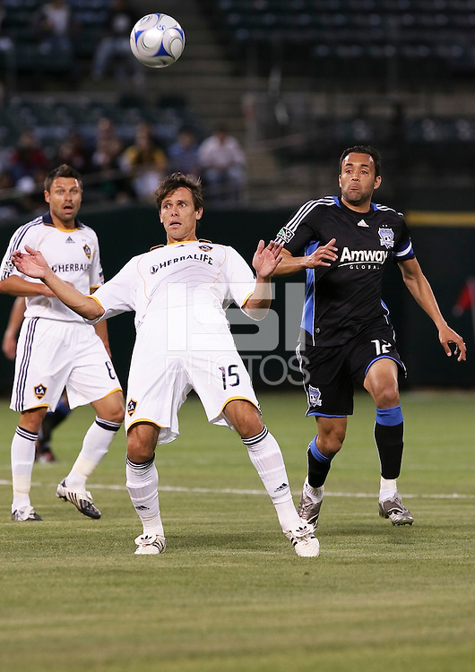 Stefani Miglioranzi (15) tries to control the ball against Ramiro Corrales (12). San Jose Earthquakes tied Los Angeles Galaxy 1-1 at the McAfee Colisum in Oakland, California on April 18, 2009.