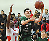 Shane Wagner #2 of Harborfields, right, drives to the net during a Suffolk County varsity boys basketball game against host Amityville High School on Thursday, Jan. 12, 2017. Harborfields won by a score of 81-41.