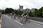 "9-8-2018: Cyclists in the ""Tour de Munster in aid of Down Syndrome Ireland supported by MACE, pictured passing by Lismore Castle in County Waterford on Thursday. <br /> Photo: Don MacMonagle<br /> <br /> pr photo photo from MACE"