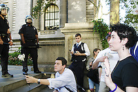 Protesters at the New York Public Library in New York City on August 31, 2004 during the Republican National Convention.  The library steps were a meeting point for a group calling itself the A31 Action Coalition which called for civil disobedience on a mass scale that day.  The library steps quickly cleared as police began arresting people, sometimes indiscriminately.