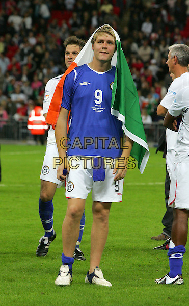 Brian McFADDEN<br /> Soccer Aid - a Charity Soccer match in aid of Unicef played at Wembley Stadium, London, England.<br /> September 7th, 2008<br /> full length football sport kit uniform white top blue shorts brian flag<br /> CAP/ROS<br /> &copy;Steve Ross/Capital Pictures
