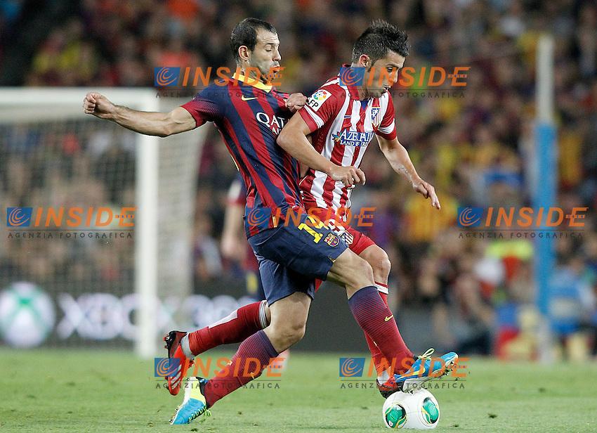 FC Barcelona's Javier Mascherano (l) and Atletico de Madrid's David Villa during Supercup of Spain 2nd match.August 28,2013. (ALTERPHOTOS/Acero) <br /> Football Calcio 2013/2014<br /> La Liga Spagna Supercoppa di Spagna Barcellona - Atletico MAdrid <br /> Foto Alterphotos / Insidefoto <br /> ITALY ONLY