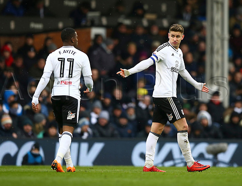 17th March 2018, Craven Cottage, London, England; EFL Championship football, Fulham versus Queens Park Rangers; Tom Cairney of Fulham gesturing towards Floyd Ayite of Fulham