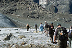 Switzlerland: Hiking the Swiss Glaciers near St. Moritz, taking the Diavolezza Morteratsch hike..Hikers on the Pers Glacier..Photo copyright Lee Foster, 510/549-2202, lee@fostertravel.com, www.fostertravel.com..Photo #: swisse11690