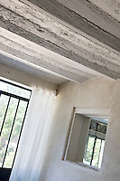 A detail illustrating the ceiling beams in the dining room which have been stripped back to a rough surface
