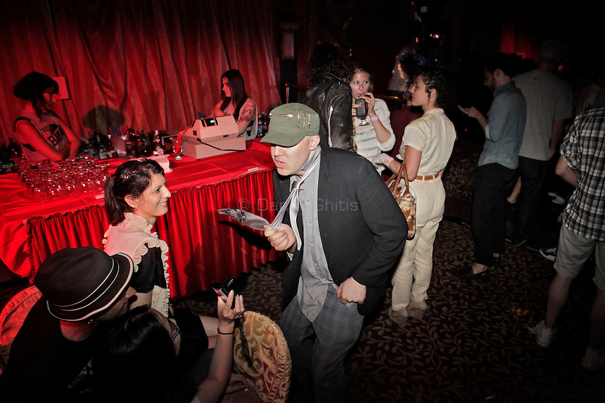 Friends talk and dance as loud dance music plays at Madam Wong night club. By day Golden Unicorn is a traditional Chinese restaurant, but it is transformed into Madam Wong, a trendy Manhattan club at night. ..Danny Ghitis for The New York Times