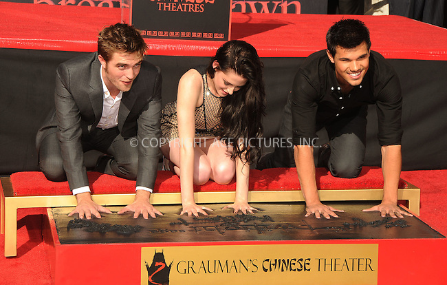 WWW.ACEPIXS.COM ************....November 3 2011, LA....Actors Robert Pattinson, Kristen Stewart and Taylor Lautner at 'The Twilight Trio' Hand/Footprint Ceremony at Grauman's Chinese Theatre on November 3, 2011 in Hollywood, California......Please byline: PETER WEST -- ACEPIXS.COM.. *** ***  ..Ace Pictures, Inc:  ..tel: (646) 769 0430..e-mail: info@acepixs.com..web: http://www.acepixs.com