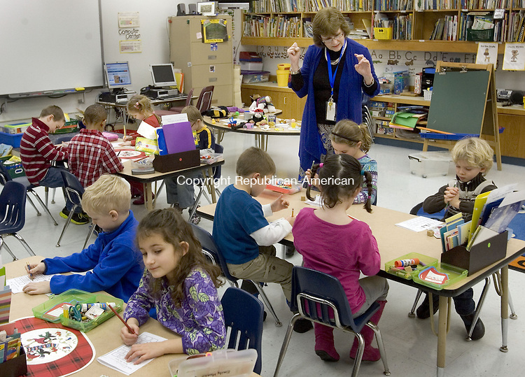 SOUTHBURY, CT. 14 January 2013-011413SV03- Kindergarten teacher Marion Bouffard works on a spelling lesson with students at Gainfield Elementary School in Southbury Monday. The Region 15 Board of Education will vote on both a full-day kindergarten and redistricting plan to take effect in the 2013-14 school year.<br />