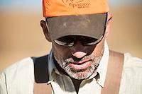 Pete Coppolillo, of Bozeman, Montana, hunts upland game birds near the Missouri River Breaks.