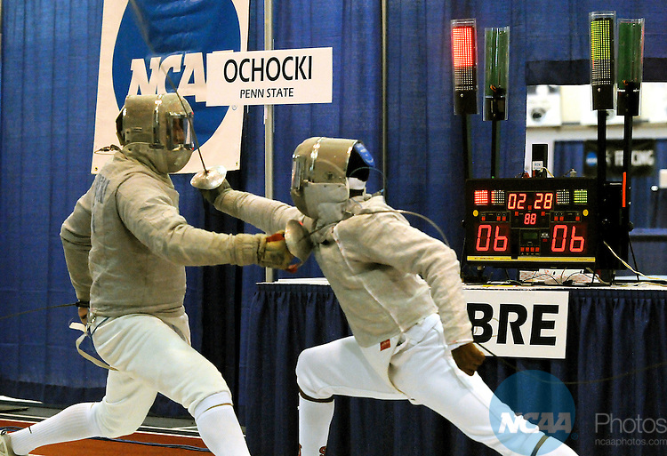 20 MAR 2009: Aleksander Ochocki of Pennsylvania State University makes a move against Daryl Homer of St. John's University during the Division I Men's Fencing championship in the weapon of Sabre held at the Multi-Sport Facility on the Penn State University campus in University Park, PA.  Ochocki defeated Homer for a 15-14 victory.  Steve Manuel/NCAA Photos