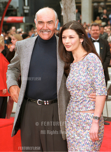 "13APR99:  Actor SEAN CONNERY, with actress CATHERINE ZETA JONES, at Hollywood's Manns Chinese Theatre where he had his hand & footprints set in cement. Their new movie, ""Entrapment,"" opens this week.    .© Paul Smith/Featureflash"