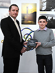 Leon Murphy winner of the under 12 to 18 section of the RTE Local Heroes photo competition receives his prize from Tadhg Leonard representing sponsors Nikon and mahers chemist. Photo: Colin Bell/pressphotos.ie