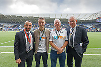 Leon Britton (L) and Alan Curtis (R) with sponsors prior to the Sky Bet Championship match between Swansea City and Preston North End at the Liberty Stadium, Swansea, Wales, UK. Saturday 17 August 2019