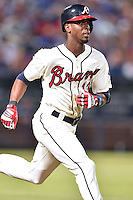 Atlanta Braves pinch hitter Pedro Ciriaco (13) runs to first during a game against the Chicago Cubs on July 18, 2015 in Atlanta, Georgia. The Cubs defeated the Braves 4-0. (Tony Farlow/Four Seam Images)