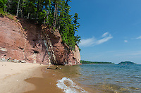 A beautiful summer day along the Lake Superior coast with sandstone cliffs and a secluded beach. Marquette, MI
