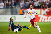 Juninho (8) of the New York Red Bulls gets past Graham Zusi (8) of Sporting Kansas City. Sporting Kansas City defeated the New York Red Bulls 1-0 during a Major League Soccer (MLS) match at Red Bull Arena in Harrison, NJ, on April 17, 2013.