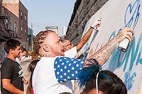 Artist, URNEWYORK, joins the fun at the kids workshop during &quot;Taking Back the Streets&quot; at Moonlight Studios in Chicago on July 18, 2014. <br />