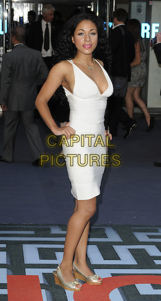 KATHRYN DRYSDALE .At the World Premiere of 'Inception' at the Odeon Leicester Square cinema, Leicester Square, London, England, .UK, July 8th 2010..arrivals full length white bandage body con dress hands on hips sleeveless cleavage gold peep toe shoes bows.CAP/CAN.©Can Nguyen/Capital Pictures.