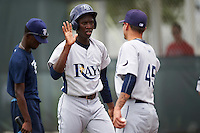 GCL Rays center fielder Jesus Sanchez (3) high fives Matt Vogel (45) after scoring a run during the first game of a doubleheader against the GCL Red Sox on August 9, 2016 at JetBlue Park in Fort Myers, Florida.  GCL Rays defeated GCL Red Sox 5-4.  (Mike Janes/Four Seam Images)