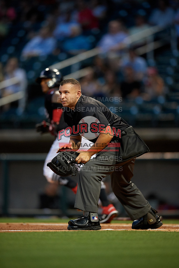 Umpire Jonathan Parra during a Southern League game between the Chattanooga Lookouts and Birmingham Barons on May 2, 2019 at Regions Field in Birmingham, Alabama.  Birmingham defeated Chattanooga 4-2.  (Mike Janes/Four Seam Images)