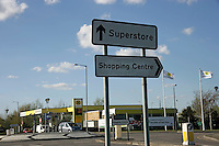 Sign for superstore and shopping centre with Morrisons petrol station in Thamesmead, southeast London, UK