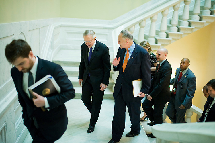 UNITED STATES - JULY 25:  Senate Majority Leader Harry Reid, D-Nev., second from left, and Sen. Charles Schumer, D-N.Y., make their way to news conference in the Capitol on a new proposal to deal with the raising of the debt ceiling.  (Photo By Tom Williams/Roll Call)