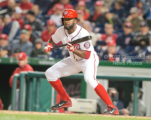 Washington Nationals center fielder Denard Span (2) lays down a bunt in the eighth inning in the game against the Florida Marlins at Nationals Park in Washington, D.C. on Wednesday, April 9, 2014.  He later scored on Jayson Werth's grand slam home run. The Nationals won the game 10 - 7.<br /> Credit: Ron Sachs / CNP