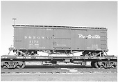 Side view of box car #3173 loaded on standard gauge flat car #X4570 at Alamosa.  This car was moved from Salida after cessation of narrow gauge operations there.<br /> D&amp;RGW  Alamosa, CO  Taken by Richardson, Robert W. - 12/14/1955