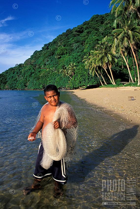 Young fisherman with nets in Vatia, Tutuila, American Samoa