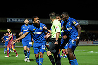 Andy Barcham  (17) of AFC Wimbledon and Deji Oshilaja of AFC Wimbledon (4) of AFC Wimbledon protest to the referee as they feel a penalty should have been given during AFC Wimbledon vs Bradford City, Sky Bet EFL League 1 Football at the Cherry Red Records Stadium on 2nd October 2018