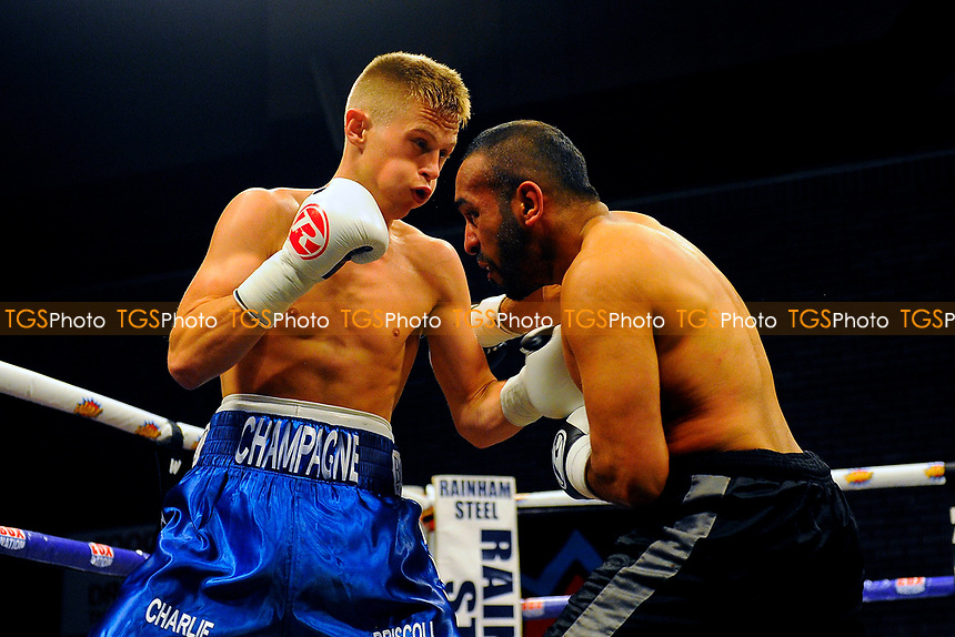 Charlie Driscoll (blue shorts) defeats Ibrar Riyaz during a Boxing Show at the Brentwood Centre on 2nd June 2017