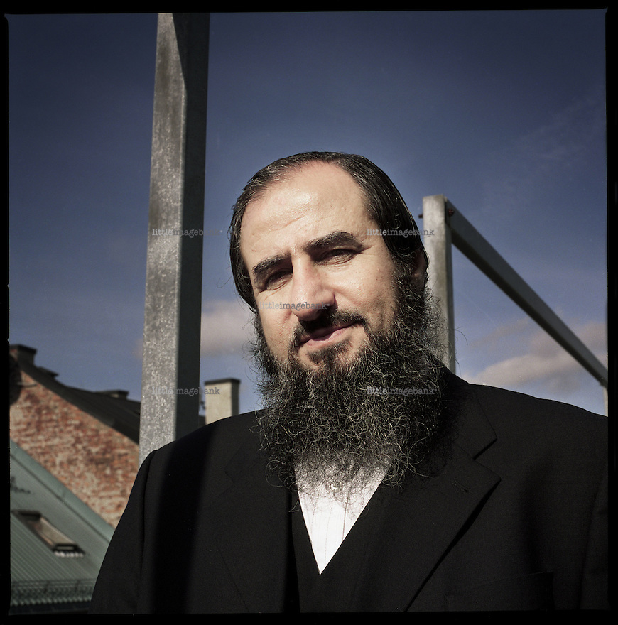 Najmuddin Faraj Ahmad (b 07.07.1956) also known as Mullah Krekar is a Kurd who came to Norway as a refugee from northern Iraq in 1991. <br /> <br /> His wife and four children have Norwegian citizenship, but not Krekar himself. He speaks Kurdish, Arabic, Norwegian and English.<br /> <br /> Krekar was the original leader of the Islamist armed group Ansar al-Islam, which was set up and commanded operations in Kurdistan while he had refugee status in Norway. Krekar claims, however, not to have had knowledge of the various terrorist attacks performed by the group he was leading. <br /> <br /> Since February 2003 he has an expulsion order against him, which is suspended pending Iraqi government guarantees that he will not face torture or execution. Norway is committed to international treaties which prohibit the expulsion of an individual without such a guarantee.<br /> <br /> Authorities in the Kurdish Regional Government have repeatedly asked for him to be extradited from Norway. The death penalty remains on the books in the Kurdistan region. Most death sentences have been changed into life sentences since the Kurdish authorities took power in 1992, the exception being that eleven alleged members of Ansar al-Islam were hanged in the regional capital of Arbil in October 2006. Krekar has as of 8 December 2006 been on the UN terror list, and as of 8 November 2007 been judged by the High Court of Norway as a &quot;danger to national security&quot;. Photo: Christopher Olss&oslash;n.