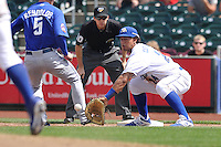 Cheslor Cuthbert #24 of the Omaha Storm Chasers gathers in a throw on a pickoff attempt at first base against the Las Vegas 51s at Werner Park on August 17, 2014 in Omaha, Nebraska. The Storm Chasers  won 4-0.   (Dennis Hubbard/Four Seam Images)