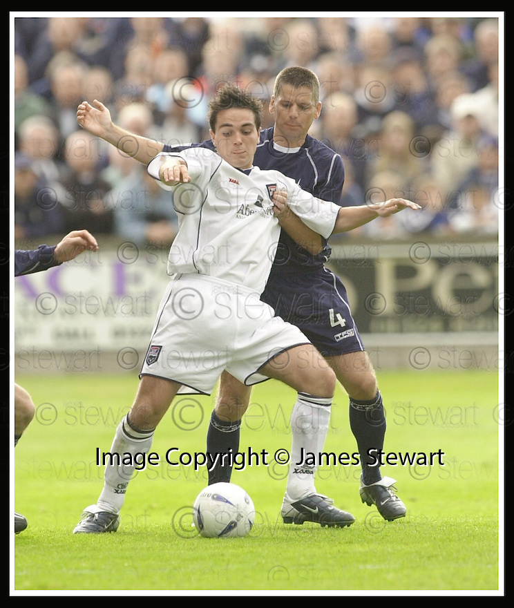 13/09/2003                   Copyright Pic : James Stewart.File Name : stewart-falkirk v ross co 07.COUNTY'S SEAN HIGGINS HOLDS OFF EDDIE MAY....James Stewart Photo Agency, 19 Carronlea Drive, Falkirk. FK2 8DN      Vat Reg No. 607 6932 25.Office     : +44 (0)1324 570906     .Mobile  : +44 (0)7721 416997.Fax         :  +44 (0)1324 570906.E-mail  :  jim@jspa.co.uk.If you require further information then contact Jim Stewart on any of the numbers above.........