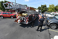 NWA Democrat-Gazette/J.T. WAMPLER Bella Vista firefighters visit with the public Sunday Sept 8, 2019 at the Bella Vista Farmers Market. The city's first responders were on hand to show some of the equipment that they use in their day-to-day operations. Free child fingerprinting was also available.<br />The Bella Vista Farmers Market operates every Sunday through October 13 from 9 a.m. to 2 p.m. in the parking lot of Sugar Creek Center. Fresh produce and locally handmade goods are available. For more information or to stay up to date of current vendors and programs, follow the market on Facebook at Bella Vista Farmers Market.