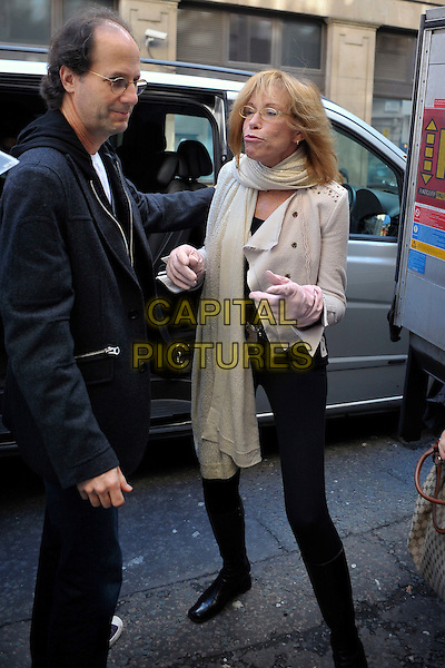 CARLY SIMON.Arriving at BBC Radio 2 studios,.London, England UK, .March 1st, 2010.full length glasses white cream beige scarf jacket black boots leggings pink gloves .CAP/DYL.©Dylan/Capital Pictures.