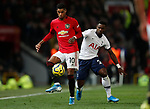 Manchester United's Marcus Rashford (L) battes for the ball with Tottenham Hotspur's Serge Aurier during the Premier League match at Old Trafford, Manchester. Picture date: 4th December 2019. Picture credit should read: Darren Staples/Sportimage
