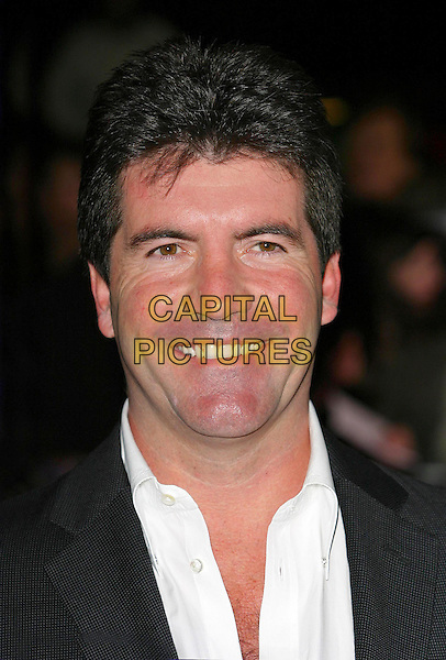 SIMON COWELL.National Television Awards 2003 Held At The Royal Albert Hall, South Kensington, London.28th October 2003  .Ref: Ten.headshot, portrait  .www.capitalpictures.com.sales@capitalpictures.com.©Capital Pictures