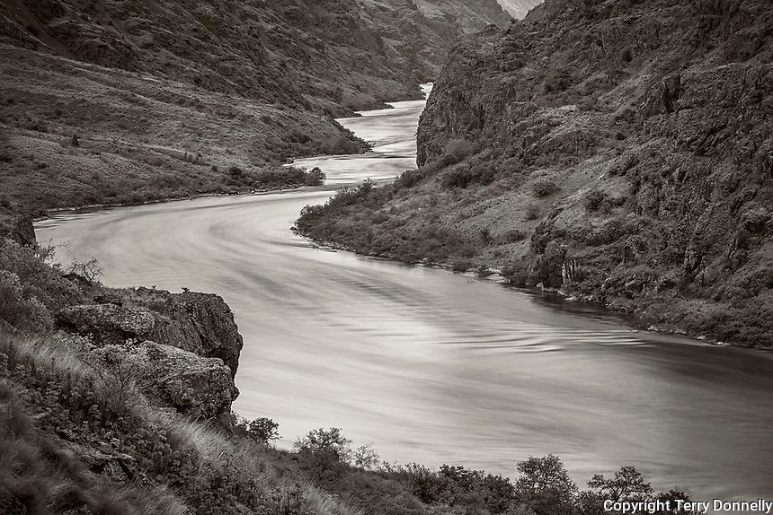 Hells Canyon NRA, Oregon/Idaho:<br /> Snake river flowing downstream reflecting the light of the evening sky. Near Battle Creek.