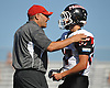 Mount Sinai varsity football head coach Vinnie Ammirato, left, talks with quarterback No. 37 Jason Shlonsky during the fourth quarter of a Suffolk County Division IV game against Babylon at Islip High School on Saturday, September 5, 2015. Mount Sinai won by a score of 19-15.<br /> <br /> James Escher