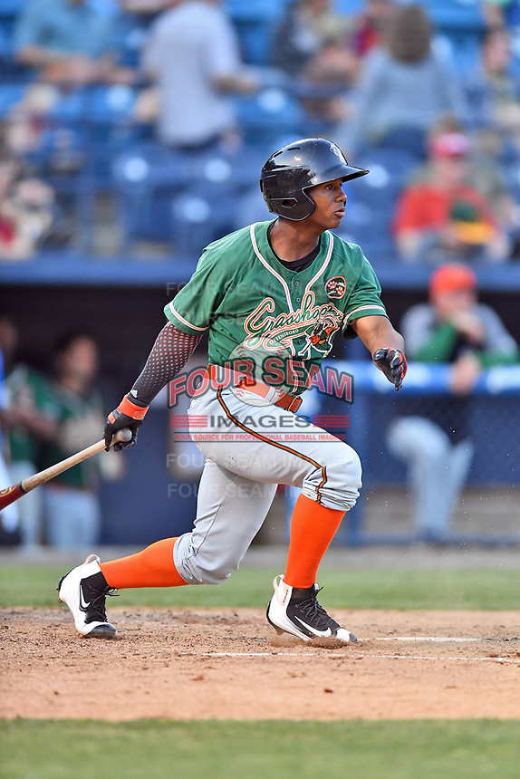 Greensboro Grasshoppers second baseman Sam Castro (20) swings at a pitch during a game against the Asheville Tourists at McCormick Field on May 10, 2018 in Asheville, North Carolina. The Tourists defeated the Grasshoppers 14-10. (Tony Farlow/Four Seam Images)