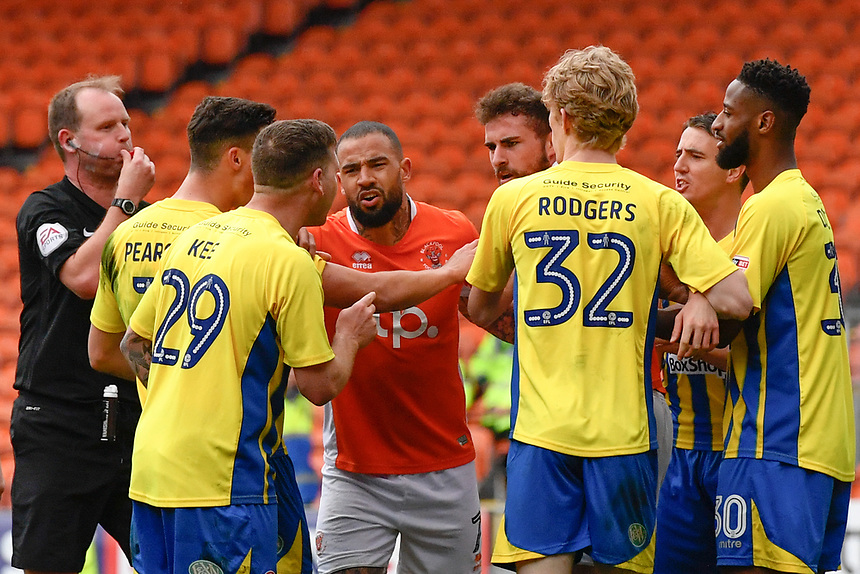Tempers flare between Blackpool's Clark Robertson and Accrington Stanley's Billy Kee<br /> <br /> Photographer Terry Donnelly/CameraSport<br /> <br /> The EFL Sky Bet League Two - Blackpool v Accrington Stanley - Friday 14th April 2017 - Bloomfield Road - Blackpool<br /> <br /> World Copyright &copy; 2017 CameraSport. All rights reserved. 43 Linden Ave. Countesthorpe. Leicester. England. LE8 5PG - Tel: +44 (0) 116 277 4147 - admin@camerasport.com - www.camerasport.com
