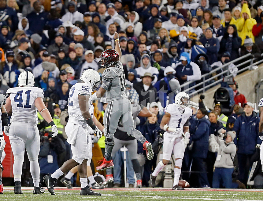 Ohio State Buckeyes quarterback J.T. Barrett (16) jumps into the air to celebrate the game winning touchdown scored by Ohio State Buckeyes tight end Marcus Baugh (85) against Penn State Nittany Lions during the 4th quarter of their game in Ohio Stadium on October 28, 2017.  [Kyle Robertson/Dispatch]