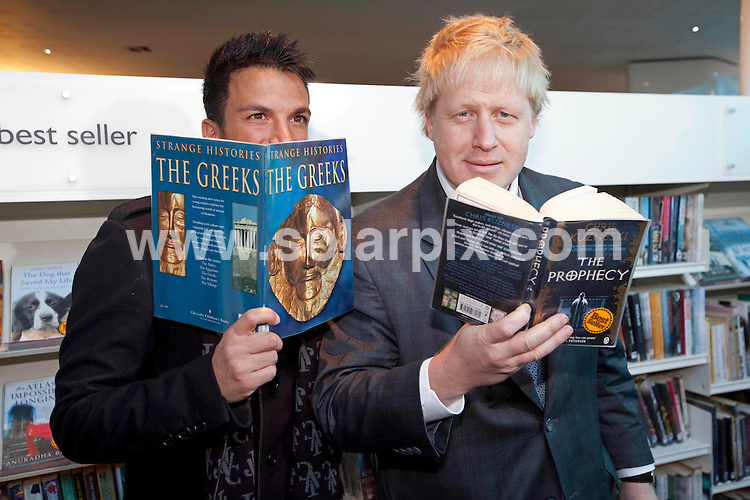 **ALL ROUND PICTURES FROM SOLARPIX.COM**                                             **NO UK NEWSPAPER PUBLICATION**.**UK MAGAZINE & SUPPLEMENT PUBLICATION ONLY** AND NO PUBLICATION IN AUSTRALIA, BELGIUM, FRANCE, GERMANY, ITALY, SCANDINAVIA AND USA**                                                                                  Caption: Mayor of London Boris Johnson and singer Peter Andre launched the  Love Libraries scheme at Shepherds Bush Library in London                                                                              This pic: Peter Andre & Boris Johnson                                                                                             JOB REF:14273        SFE       DATE:06.12.2011                                                            **MUST CREDIT SOLARPIX.COM OR DOUBLE FEE WILL BE CHARGED**                                                                      **MUST AGREE FEE BEFORE ONLINE USAGE**                               **CALL US ON: +34 952 811 768 or LOW RATE FROM UK 0844 617 7637**