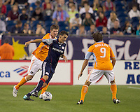 New England Revolution midfielder Marko Perovic (29) dribbles as Houston Dynamo defender Bobby Boswell (32) pressures. The New England Revolution defeated Houston Dynamo, 1-0, at Gillette Stadium on August 14, 2010.