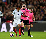 Raheem Sterling of England tackled by Scott Brown of Scotland during the FIFA World Cup Qualifying Group F match at Wembley Stadium, London. Picture date: November 11th, 2016. Pic David Klein/Sportimage