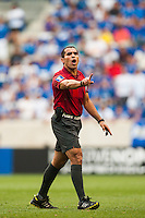 Referee Marco Rodriguez during a CONCACAF Gold Cup group B match between El Salvador and Trinidad and Tobago at Red Bull Arena in Harrison, NJ, on July 8, 2013.